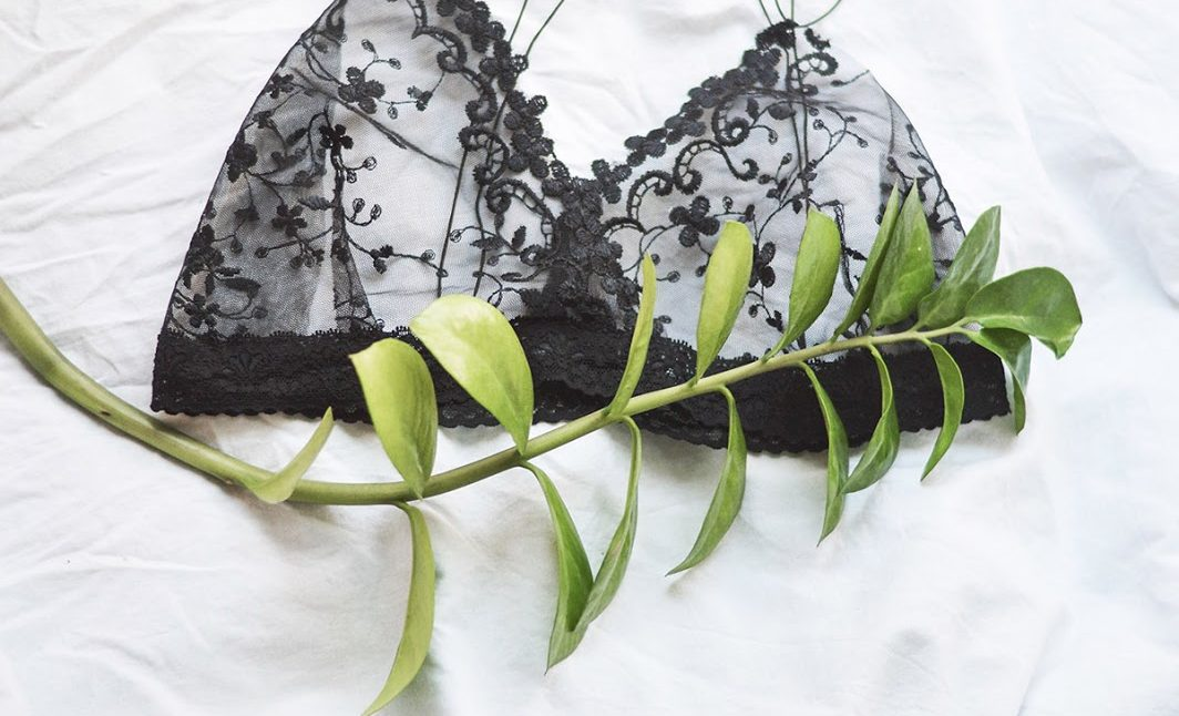 Learn how to make a DIY minimal lace bralette by yourself using sheer, embroidered fabric and a black lace ribbon. Sewing for beginners!